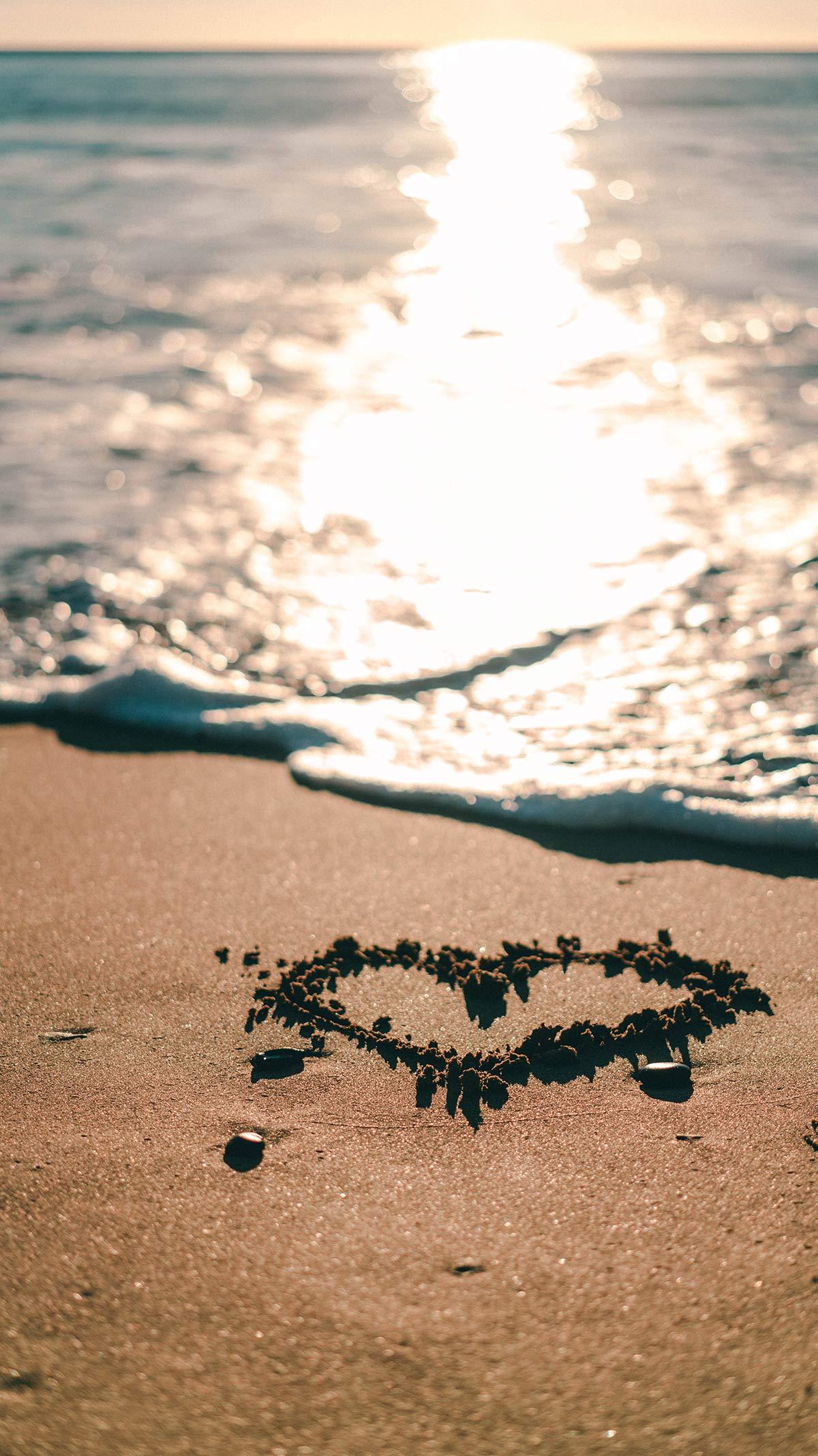 Herz in Sand gemalt